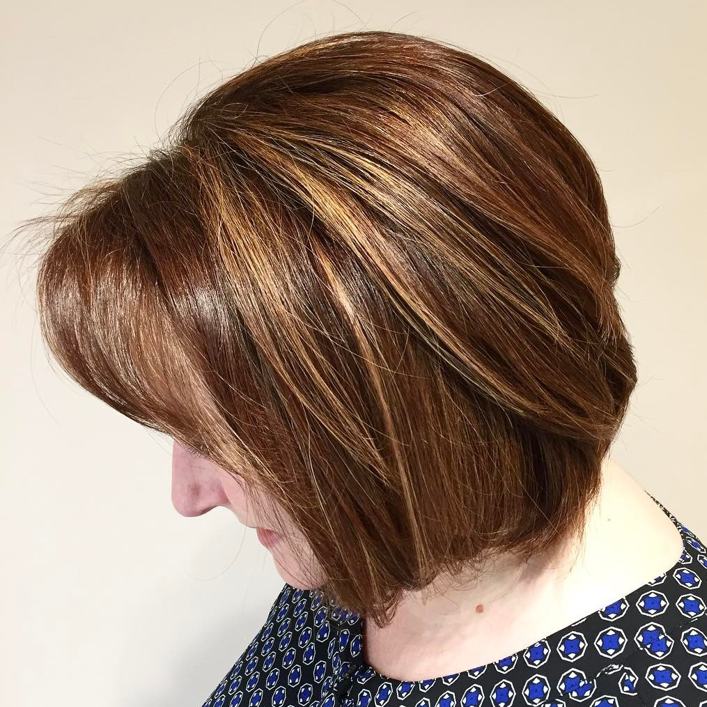 Sleek Auburn Bob with Blonde Highlights